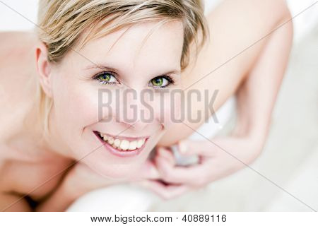Attractive Portrait Of Cheerful Smiling Girl.