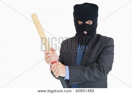 Smiling businessman dressing like a burglar while holding a baseball bat