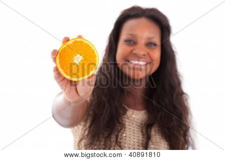 Young African American Teenage Girl Holding A Sliced Orange