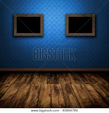 Dark Vintage Room With Wooden Floor And Old Frames On The Wall