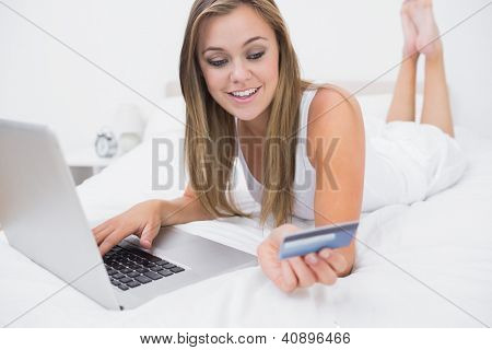 Blonde woman buying on website with her credit card