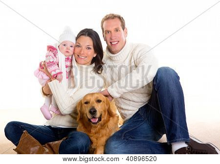 Baby girl mother and father family happy in winter with golden retriever dog