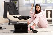 stock photo of nightie  - Displeased tired young woman in pyjama getting ready for work - JPG