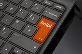 stock photo of qwerty  - Help Return Key symbolizing a user requesting support to help repair a crashed or damaged computer - JPG