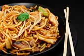 stock photo of chow  - Chicken chow mein a popular oriental dish available at chinese take outs - JPG