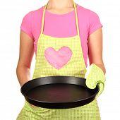 stock photo of homemaker  - Closeup of  homemaker in apron  holding  pan isolated on white - JPG