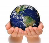 stock photo of save earth  - Woman holding globe on her hands - JPG
