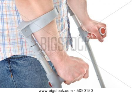 Man Walking With A Crutch