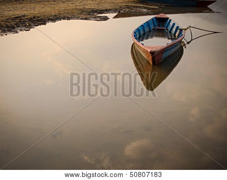 Rowing Boat Floating on a Lake