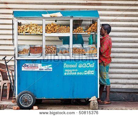 Bentota, Sri Lanka - Apr 27: Man Buys Food In Small Portable Street Shops On Apr 27, 2013 In Bentota