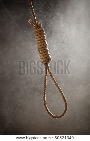 Hangman Noose With Thirteen Loops On A Dusty Background