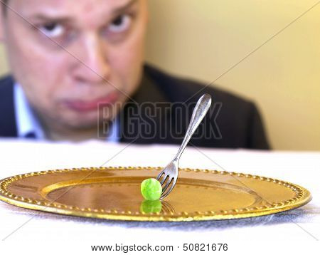 pea on golden plate
