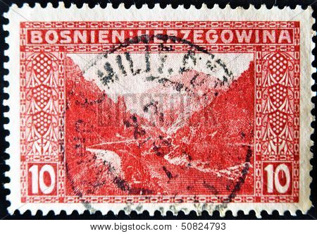 Stamp printed in Bosnia shows mountains rivers and road