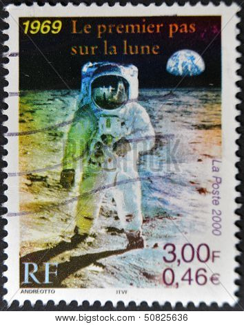 A Stamp Printed In France Shows The First Man On The Moon, Neil Armstrong
