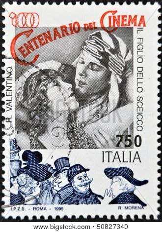 A stamp printed in Italy shows Rudolph Valentino in the film The Son of the Sheik