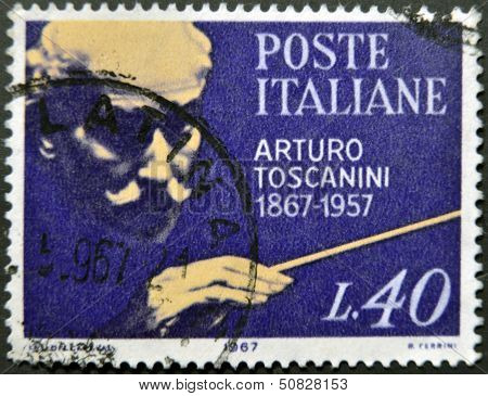a stamp celebrates the first centenary of Arturo Toscanini birth the famous italian conductor