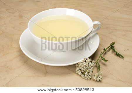Porcelain cup with tea