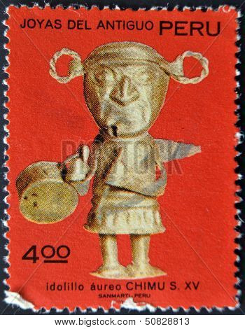 A stamp printed in Peru shows Chimu aureus idol belonging to the fifteenth century