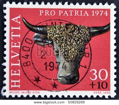 A stamp printed in Switzerland shows sculpture of a bull's head valere museum sion