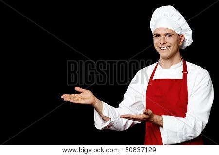 Smiling Male Chef Presenting Something