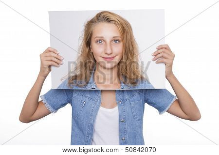 Girl Holds Her Picture In Front Of Her Face