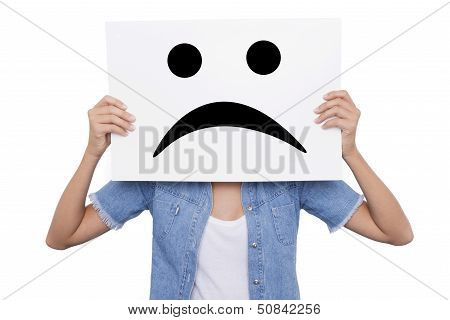 Young Girl Holding A Sign With A Sad Smiles Face Front Of Her