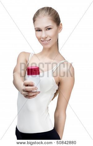 young blond woman holding antiperspirant
