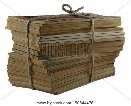 Pile Of Yellowed Magazines
