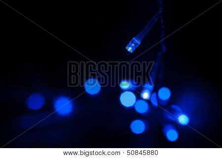 Blue Led (light Emitting Diodes) Lights Garland On Black Background