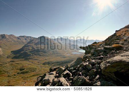 Alpine Valley Seen From A Rocky Ridge. Hiking In Swiss Alps. Switzerland.