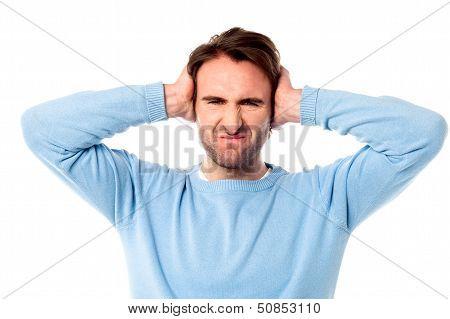 Irritated Man Blocking His Ears