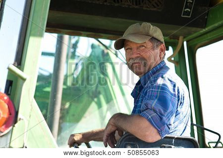 Farmer in his Tractor