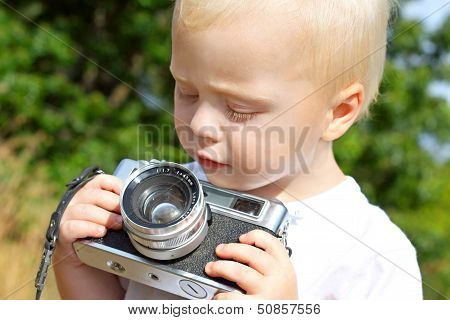 Baby Boy Playing With Vintage Camera