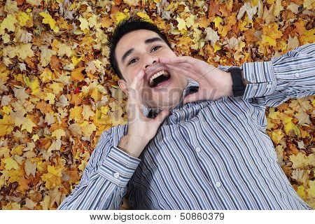 Asian Young Man Shouting On Leaves