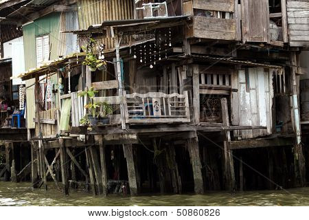Shanty house in Bangkok water canals along the river bank, Thailand