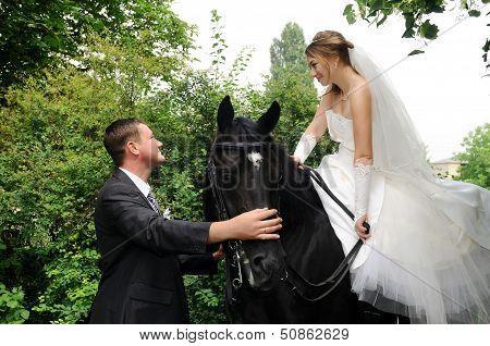 Wedding Bride And Groom On Horseback