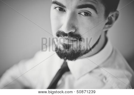 Black-and-white image of posh guy looking at camera