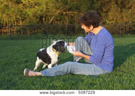 Senior Woman And Canine Companion