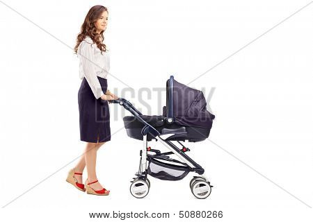 Full length portrait of a mother pushing a baby stroller, isolated on white background