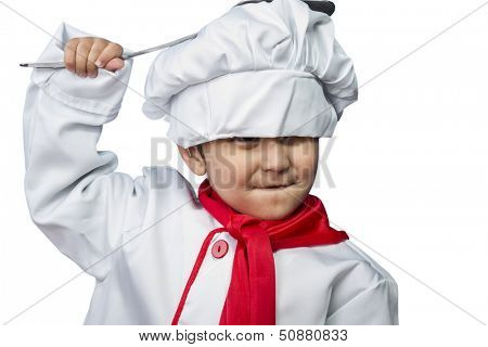Isolated, funny child dressed as a cook with a pan hitting the head