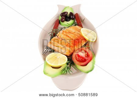 served fish: roast salmon fish over glass plate isolated over white background