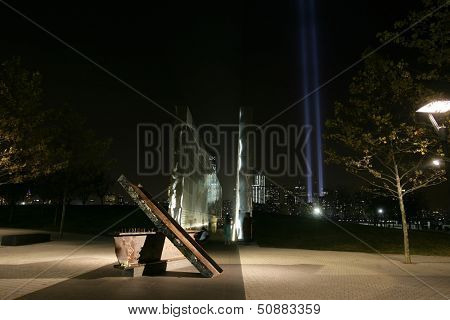 JERSEY CITY, NJ - SEPTEMBER 11: The Empty Sky 9/11 Memorial in Jersey City is shown as the Tribute in Light installation appears in lower Manhattan on September 11, 2013 in Jersey City, New Jersey.