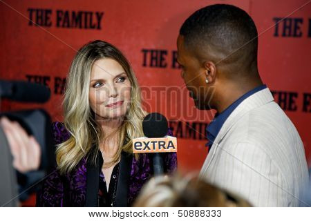 NEW YORK-SEP 10: Michelle Pfeiffer speaks with A.J. Calloway at