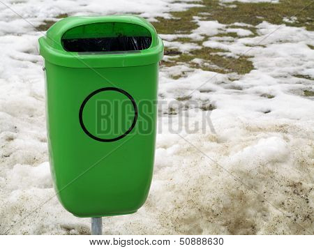 Green Pastic Garbage Bin Or Can On Street