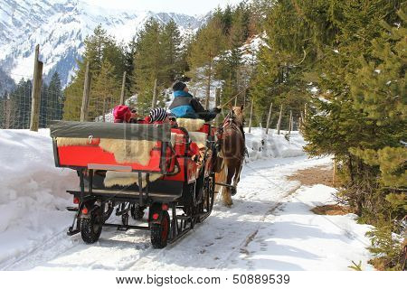 TYROL, AUSTRIA -  MARCH 17 : People enjoying a traditional horse carriage ride during the winter time in Tyrol on March 17, 2013