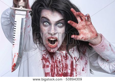 Scary Horror Image of a Bleeding Psychotic Woman With Knife