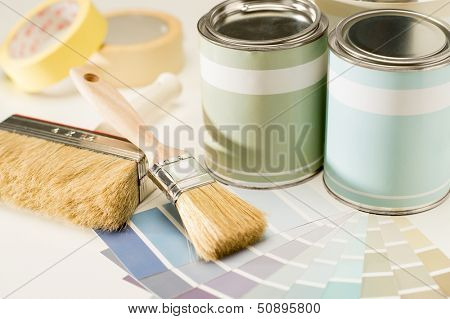A selection of painting supplies swatch, brush and can