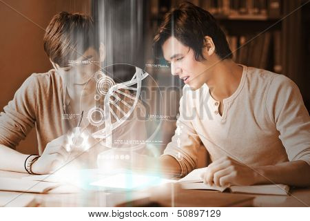 Happy college students analyzing dna on digital interface in university library