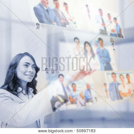 Content businesswoman selecting pictures on digital screen