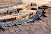 stock photo of paving  - Pavers meets with patio steps and job completion almost done steps have rain - JPG